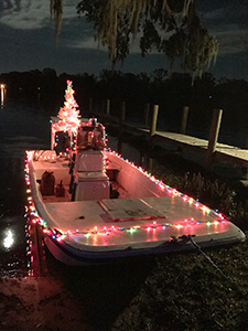 boat with christmas lights